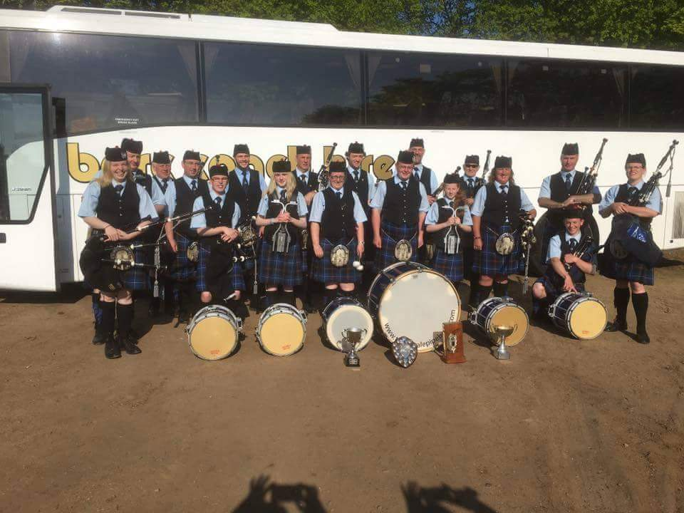 Tweedvale PB back at the bus with a haul of trophies